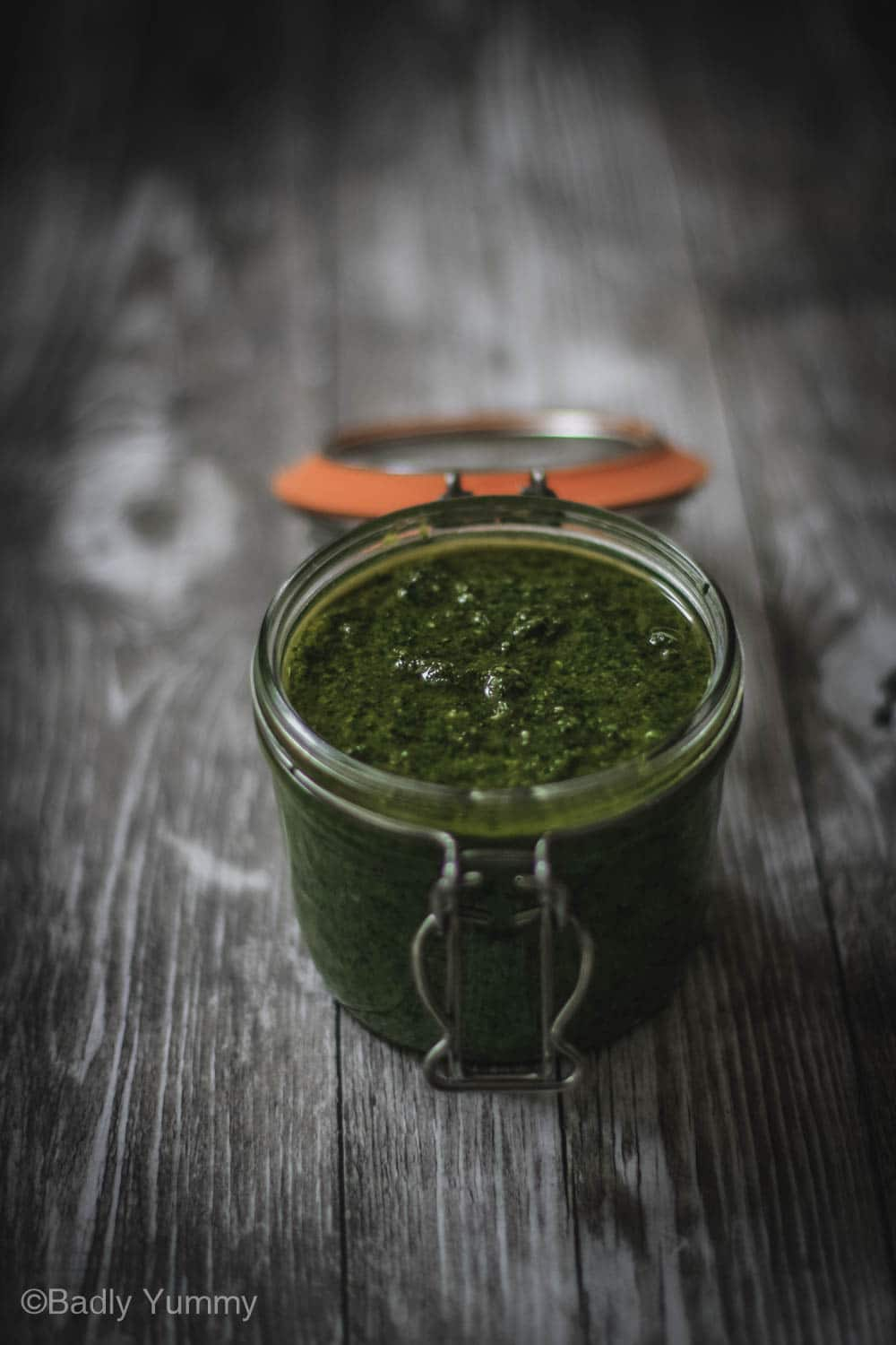 Walnut pesto in a glass jar.