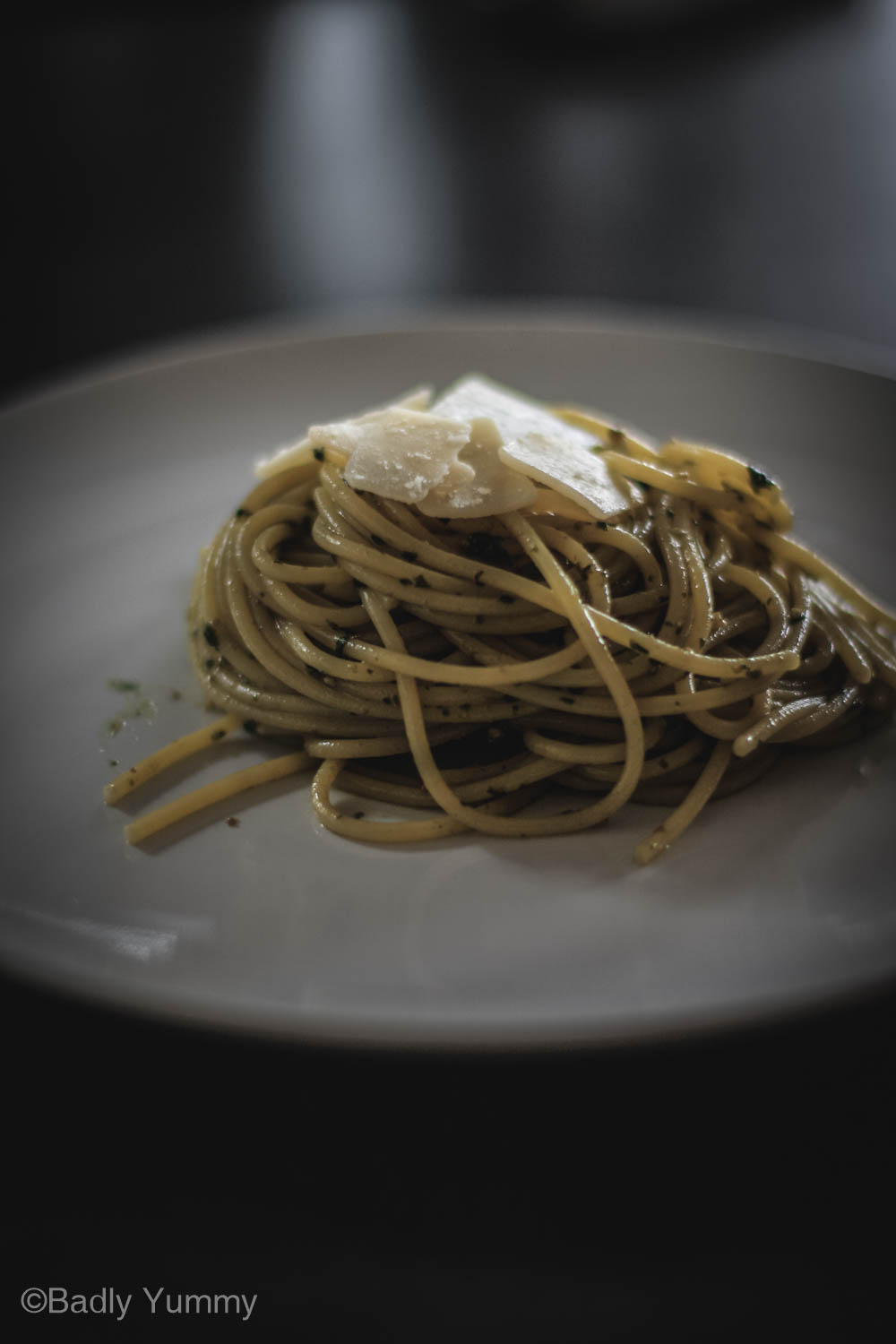 Juicy pesto pasta - Pasta with a lots of pesto sauce on a white plate