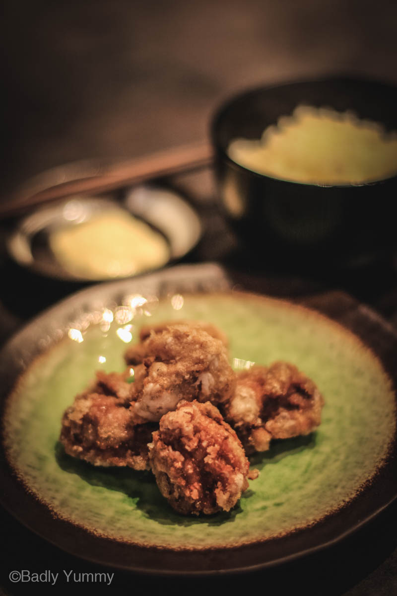 Karaage - Japanese crispy chicken nuggets on Japanese green plate