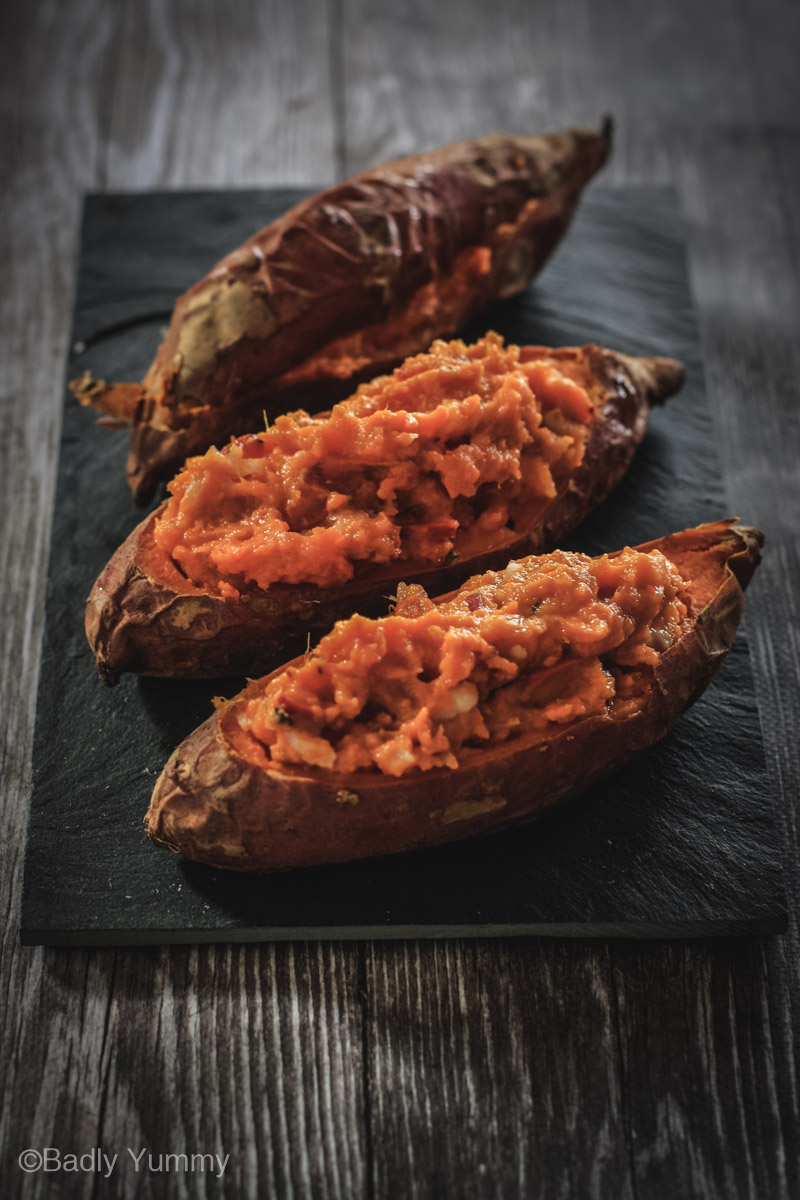 Sweet potatoes with stuffing before cooking on a slate