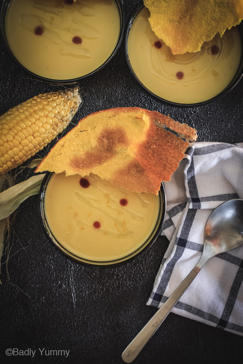Cold corn soup with crispy corn craker from the top.